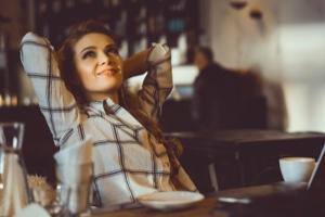 Reclining woman in a coffeeshop