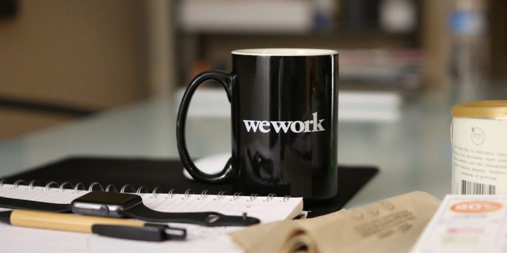 We Work coffecup closeup on a desk
