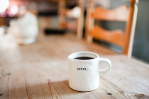 Work. coffee cup on a wooden table