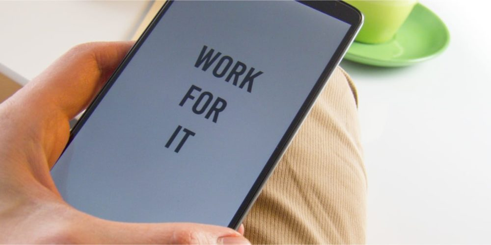 Work for It slogan on a tablet